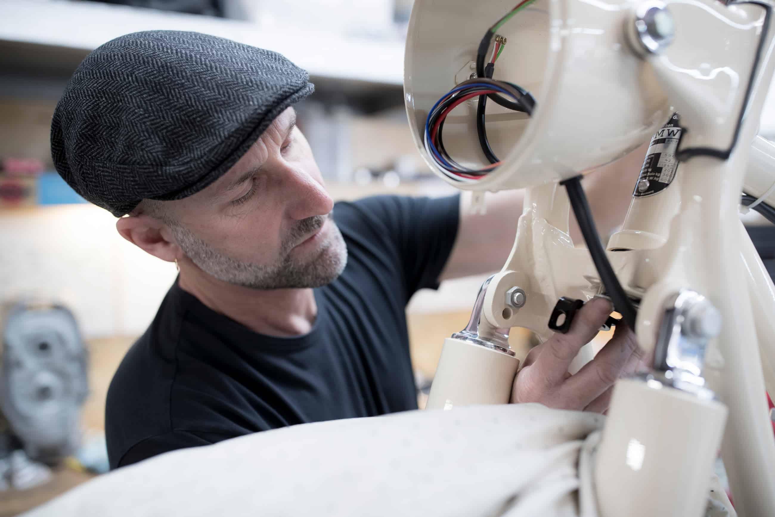 Tim Stafford, of Stafford Restorations, works on an R69S